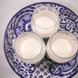 paleo banana pudding in three glasses