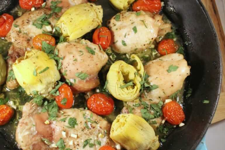 tomato & artichoke chicken dinner has only 5 ingredients and took about 2 minutes to assemble and throw in the oven. Plus, you can cook the entire thing in a cast iron pan!