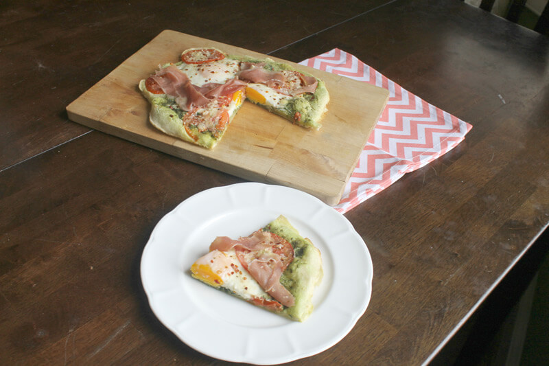 Paleo Breakfast Pizza with paleo pizza crust made from tapioca flour served on a rustic table