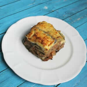 a piece of healthy moussaka on a white plate