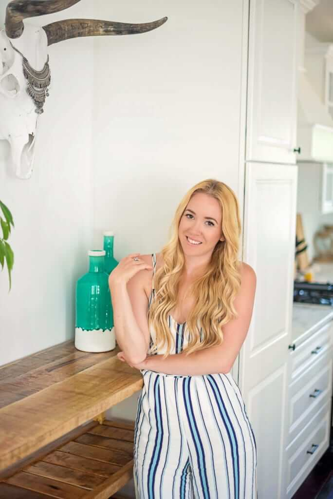 Picture of a woman in a striped dress standing in her kitchen
