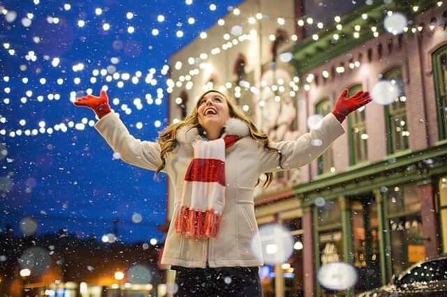 a girl admiring the Christmas decoration in the streets