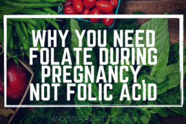 assorted vegetables on a dark wood table, with the overlaying text: Why you need folate during pregnancy, not folic acid
