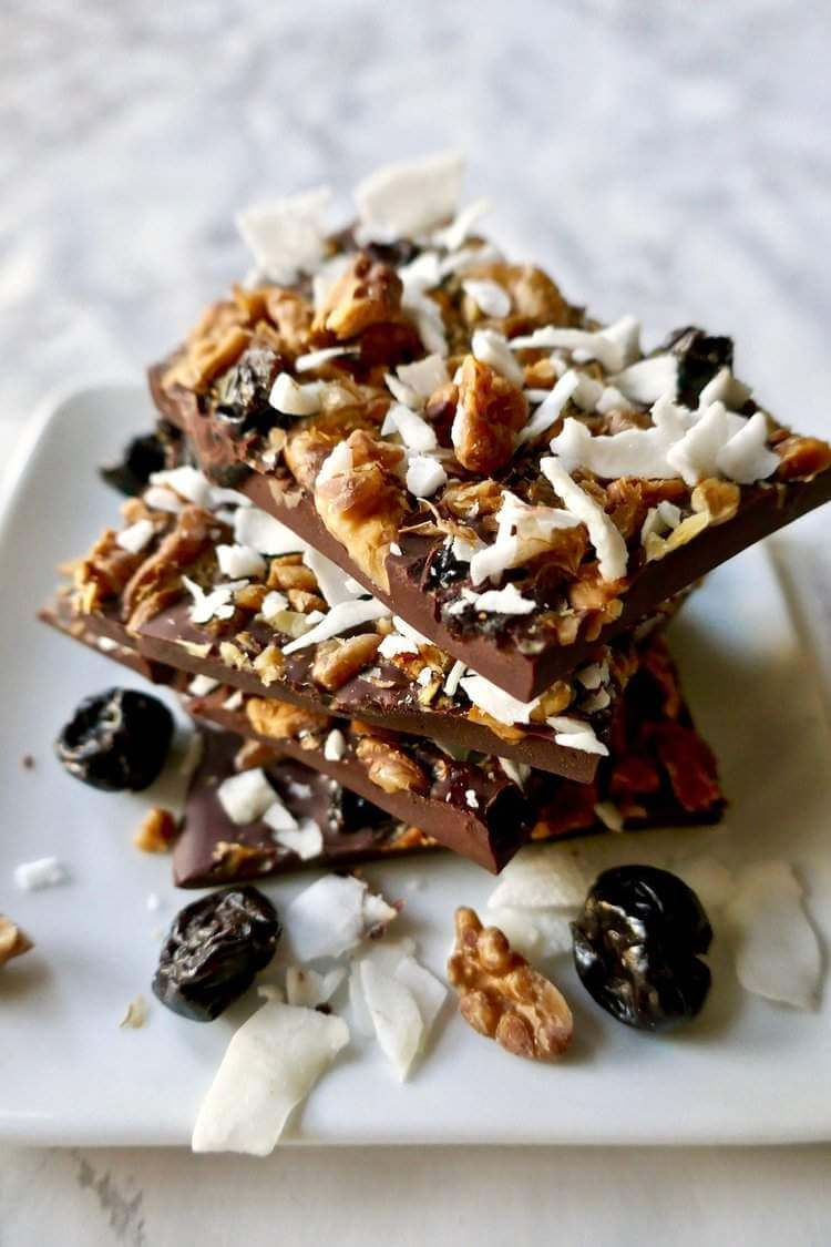Paleo Chocolate cherry nut bark stacked on top of each other