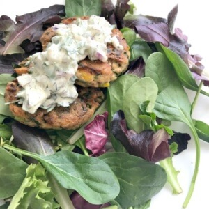 healthy salmon cakes served on leafy greens