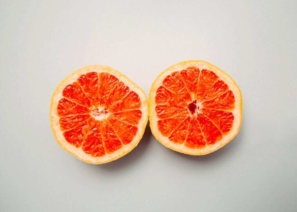 two round slices of ruby red grapefruit placed next to each other