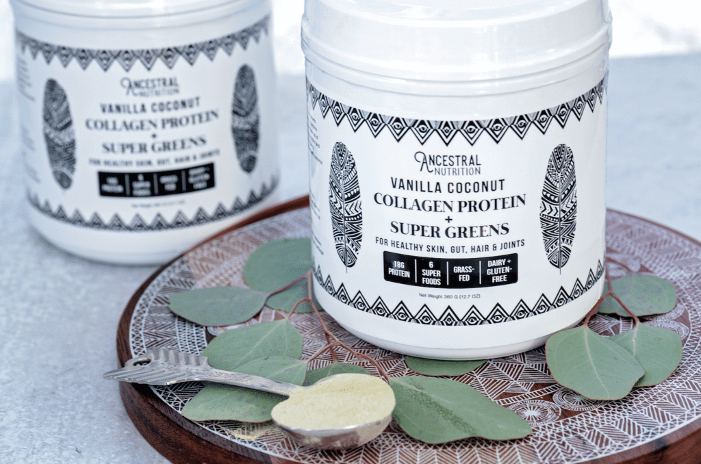 two tubs of organic collagen protein and super greens powder used to prevent stretch marks during pregnancy